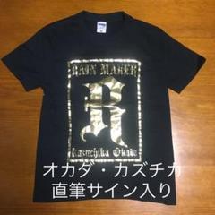 "Thumbnail of ""オカダ・カズチカ直筆サイン入りTシャツ"""