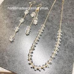 "Thumbnail of ""1. 天然石水晶AAAボタンカット高品質 ネックレス、ピアス セット"""