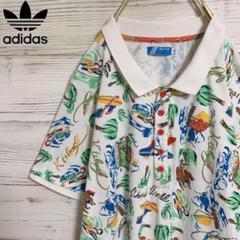 """Thumbnail of """"【美品】adidas originals ワンポイントロゴ入り変形Tシャツ 総柄"""""""