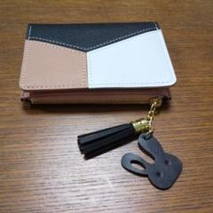 "Thumbnail of ""黒とピンクの折り畳み財布"""