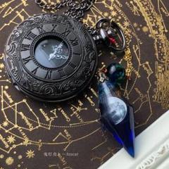 "Thumbnail of ""上弦の月が刻を司る懐中時計 宇宙レジンの蓄光ペンデュラム付きのオルゴナイト時計"""