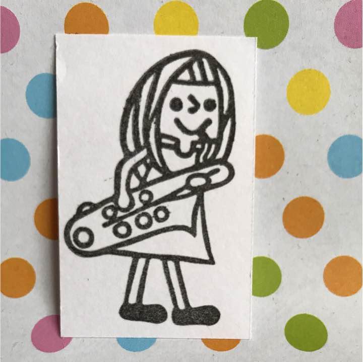 メルカリ バリトンサックスを吹いてる女の子はんこロングヘア