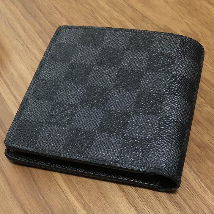 reputable site 35f12 06810 かみまる様専用 ルイヴィトン ダミエグラフィット 財布(¥33,000) - メルカリ スマホでかんたん フリマアプリ