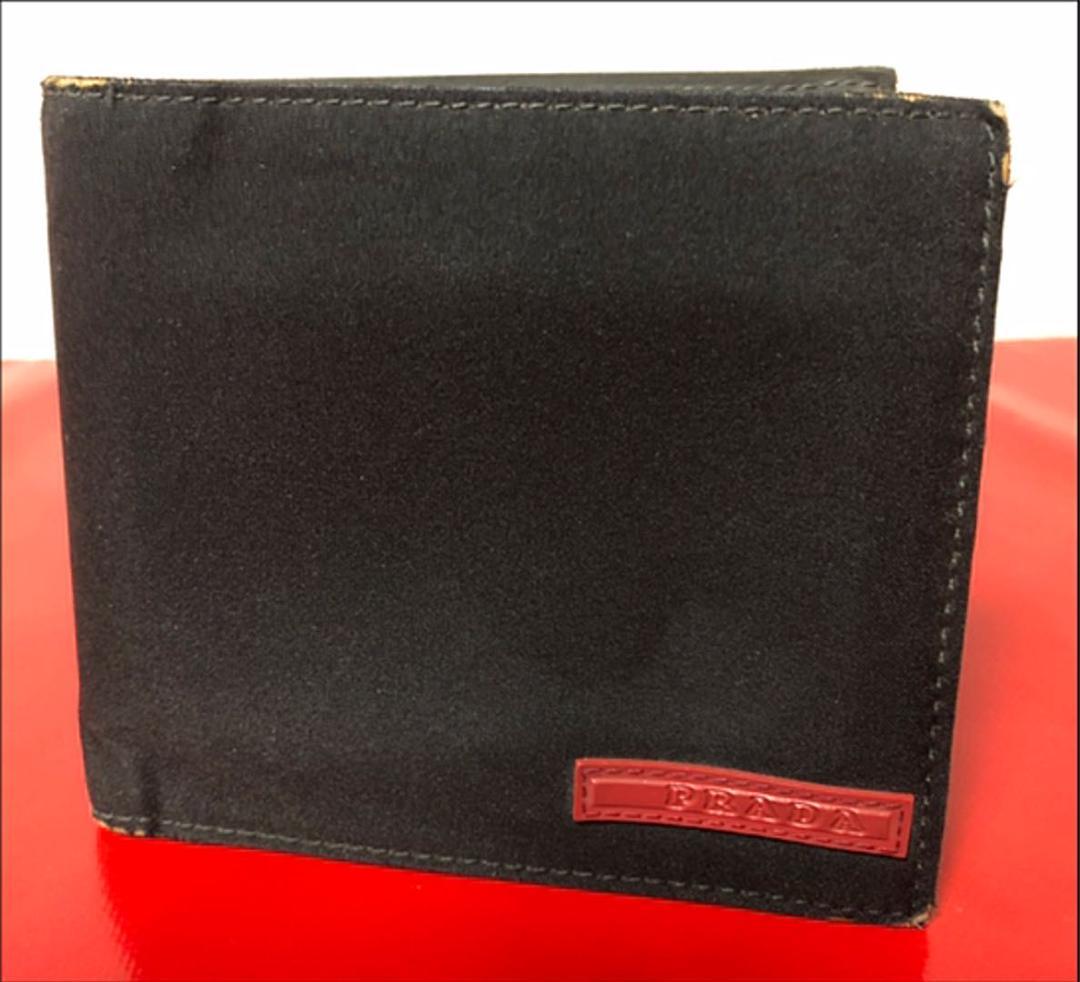 sale retailer 9f3bc b7572 PRADAスポーツ メンズ 二つ折りナイロン財布!コンパクト シンプルウォレット(¥750) - メルカリ スマホでかんたん フリマアプリ