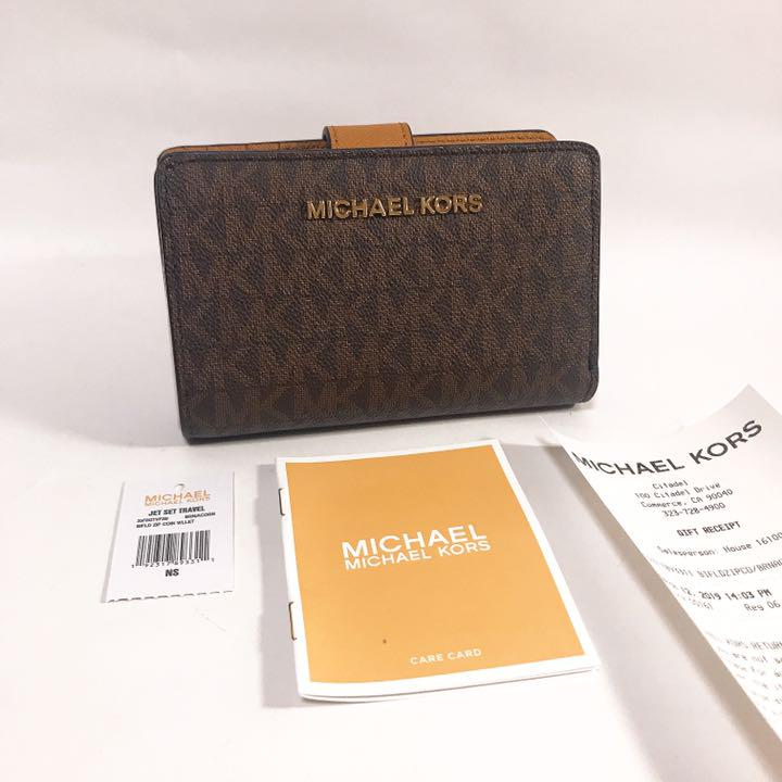 new product f9797 d2f69 大人気!MICHAEL KORS MK柄 折り財布 ブラウン/MK(¥9,800) - メルカリ スマホでかんたん フリマアプリ