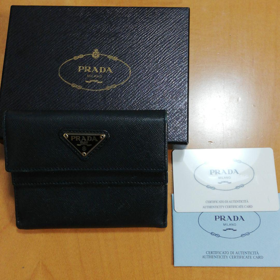 4682013cbb65 メルカリ - PRADA プラダ 財布 2つ折り 【折り財布】 (¥6,500) 中古や未 ...