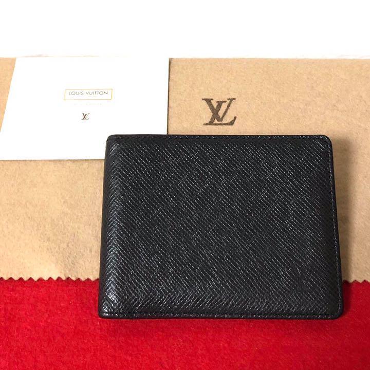 wholesale dealer 95536 7166c ルイヴィトン LOUIS VUITTON タイガ 二つ折り 財布 ブラック 黒(¥18,700) - メルカリ スマホでかんたん フリマアプリ